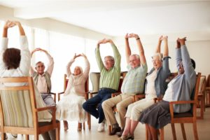 Senior Adults Stretching at Silver Birch Assisted Living Community
