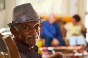 Happy senior relaxing in senior living community at Silver Birch